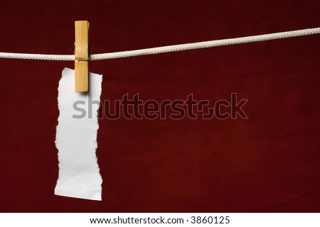 scrap paper attach clothes-peg to rope on venous background