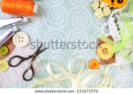 Scrapbooking craft materials on light background