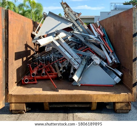 Scrapped metal garbage or construction waste inside a rubble container with the front door open. Photo stock ©