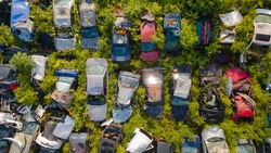 Scrapyard Aerial View. Old rusty corroded cars in car junkyard. Car recycling industry from above.