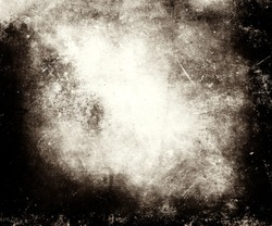 Scratched grungy texture with frame and faded central area for your text or picture useful as background
