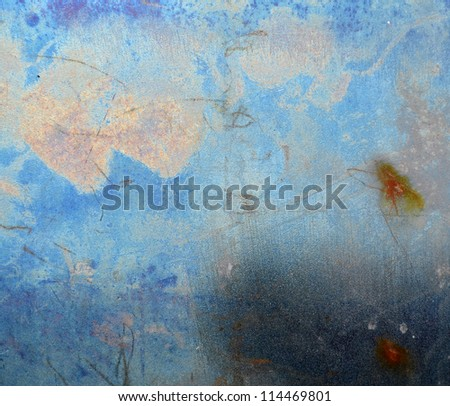 Scratched metal texture, blue color background