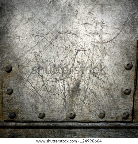 scratched riveted metal plate ; abstract industrial background