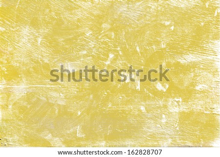 Scratched texture, uneven walls Designed background uneven patches of yellow wall