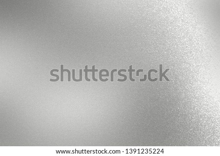Scratches on silver metallic sheet, abstract texture background