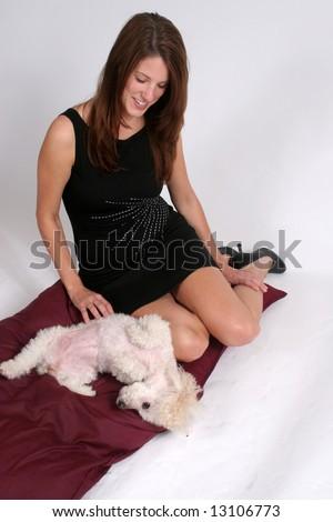 Scratching her pet dog
