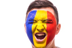 Scream in game emotions of Romanian football fan in game supporting of Romania national team on grey background. European 2016 football fans concept.