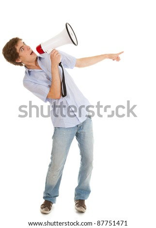 screamimg young man holding megaphone and pointing, white background