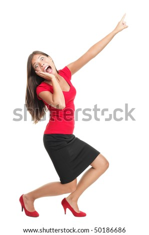 Screaming and pointing woman. Funny full length image of a beautiful mixed race caucasian / chinese young woman model dressed casual in red. Isolated on white background.
