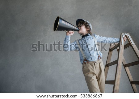 screaming boy with a megaphone