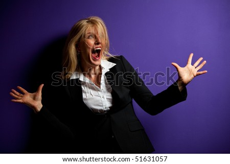 screaming business woman on a purple wall