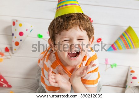 Screaming child in birthday party, cute boy crying.