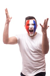 Screaming France football fan of disturbance game  of France national  team.  Big smile, scream, Hands over head. European  football fans concept.
