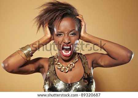 Screaming frustrated african woman pulling her hair