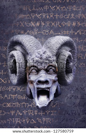 Screaming goat-horned devil against a background of mysterious alchemy symbols.