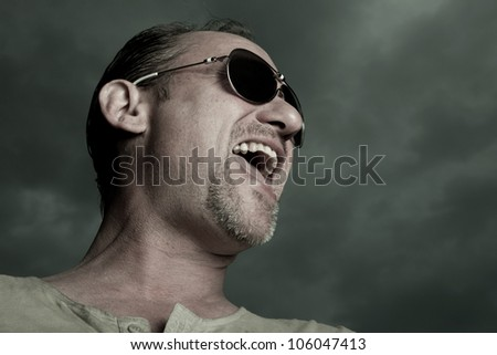 Screaming man with glasses