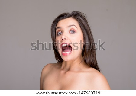Screaming naked topless woman