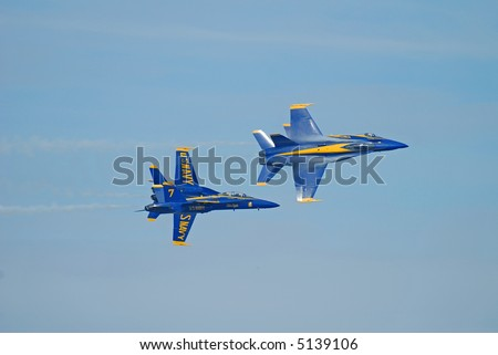 Screaming U.S. Navy Blue Angels with Vapor Trails