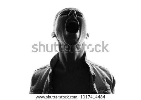 Screaming woman silhouette,back lit light
