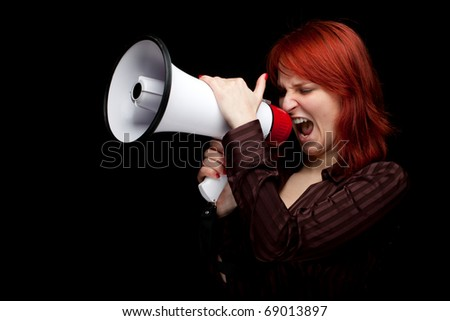 screaming young red hair woman with megaphone