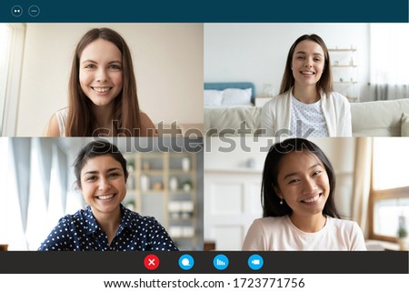Screen application view of multiracial smiling girlfriends have fun chatting talking on video call from home, happy diverse female friends engaged in online webcam conversation on computer, using app