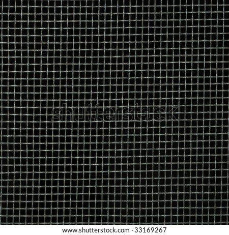 Screen door detail pattern against dark background. #33169267