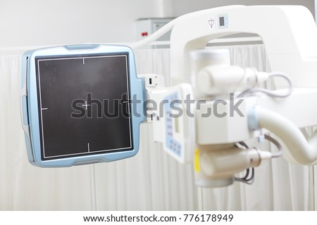 Screen of modern radiological equipment in hospital with nobody around