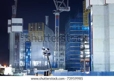 screen system and scaffold on the construction building at night (gold coast,qld,australia,march 2011)