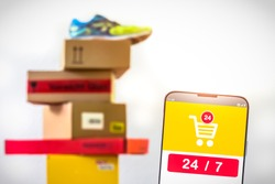 Screenshot of a Mobile Shopping App with the Numbers 24 7 and Pile of Parcels in the Background