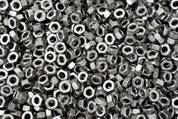 Screw, bolt and nut in black and white for industrial background