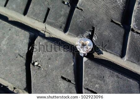 screw puncturing tire