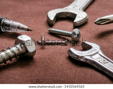 Screwdriver, wrench, mechanic equipment Put on a brown cloth #1410564563
