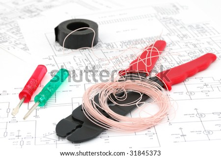 Screwdrivers, wires, a tool for cabling, electric schemes
