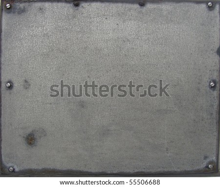 screwed metal plate sheet with some rust and wear