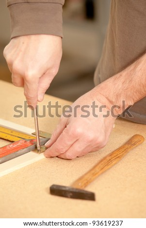 screwing a screw into the wood