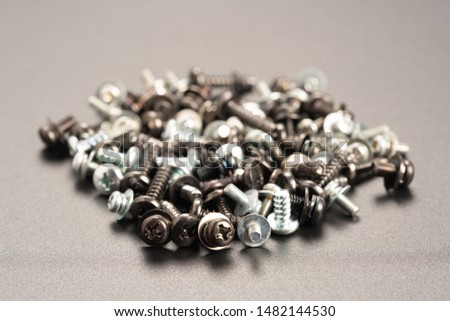 Screws and bolts fasteners industrial black background #1482144530