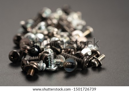 Screws and bolts fasteners industrial black background #1501726739