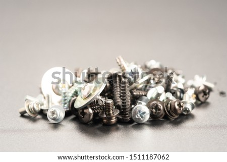 Screws and bolts fasteners industrial black background #1511187062