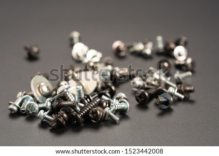 Screws and bolts fasteners industrial black background #1523442008