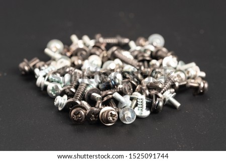 Screws and bolts fasteners industrial black background #1525091744