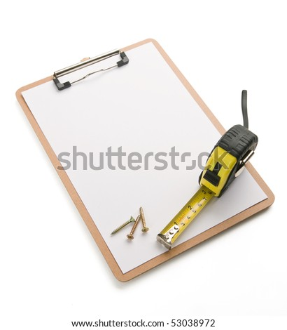 screws, tape measure laying on blank clipboard. Concept of construction work or carpenter work.