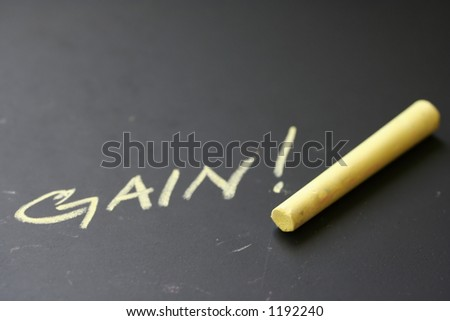 Scribble down the facts : Word  'gain' written in yellow chalk on black board