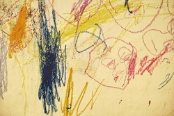scribble on a wall by a child.  Photos of abstract images on the wall