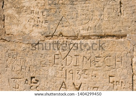 scribbled inscriptions on the wall on a building in Mdina Malta vandalism