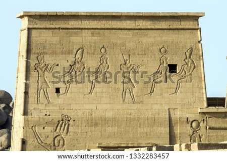 scripts and engraved shapes at Egyptian Temple in Aswan #1332283457