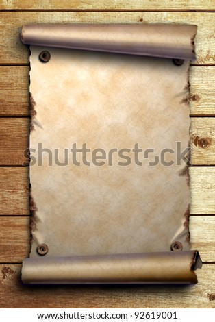 Scroll of old paper is attached with nails on wooden boards