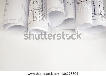 Scrolls of architectural drawings The desk architect