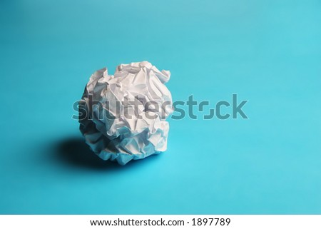 Scrunched paper on a blue background