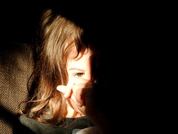 Scrutinizing child brown eye visible in the sunlight
