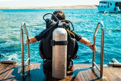 Scuba diver before diving. A diving lesson in open water.